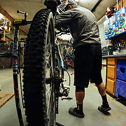 Chris Cook maintains his bike after a ride in Eagle, Colorado.