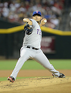 PHOENIX, AZ - MAY 27:  Pitcher Martin Perez #33 of the Texas Rangers pitches against the Arizona Diamondbacks in the first inning of an interleague game at Chase Field on May 27, 2013 in Phoenix, Arizona.  (Photo by Jennifer Stewart/Getty Images) *** Local Caption *** Martin Perez