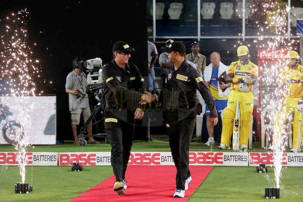 Standing umpires HDPK Dharmasena and Ron Tucker walking out onto the field during the second semi final match of the Oppo Champions League Twenty20 between the Kings XI Punjab and the Chennai Super Kings held at the Rajiv Gandhi Cricket Stadium, Hyderabad, India on the 2nd October 2014. Photo by:  Jacques Rossouw / Sportzpics/ CLT20<br /> <br /> <br /> Image use is subject to the terms and conditions as laid out by the BCCI/ CLT20.  The terms and conditions can be downloaded here:<br /> <br /> http://sportzpics.photoshelter.com/gallery/CLT20-Image-Terms-and-Conditions-2014/G0000IfNJn535VPU/C0000QhhKadWcjYs
