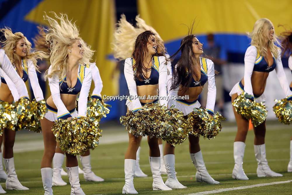 The San Diego Chargers cheerleaders do a dance routine during the 2015 NFL preseason football game against the Dallas Cowboys on Thursday, Aug. 13, 2015 in San Diego. The Chargers won the game 17-7. (©Paul Anthony Spinelli)