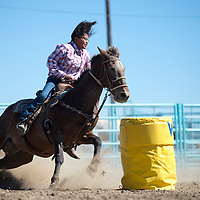 100214      Cayla Nimmo<br /> <br /> Nakeisha Martin competes in the Junior Co-ed Barrel Racing event Thursday afternoon at the Northern Navajo Nation Fair in Shiprock.