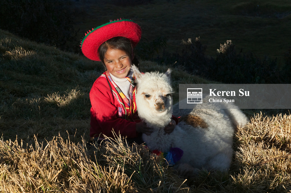 Indian girl with alpaca, Sacsayhuaman, Cuzco, Peru