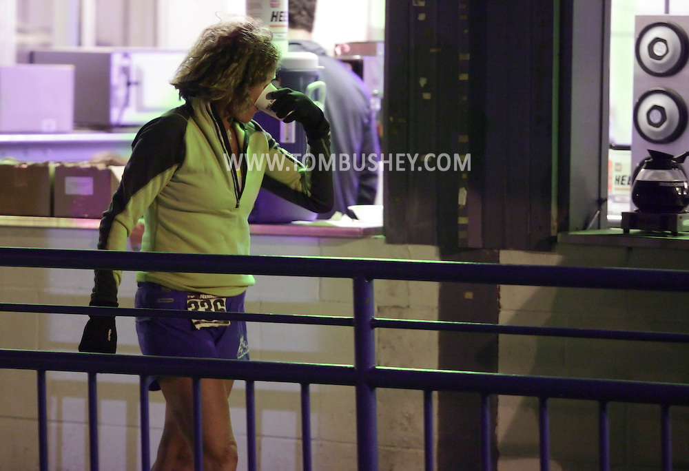 Augusta, New Jersey - Liz Bauer takes a drink at night during the 3 Days at the Fair races at Sussex County Fairgrounds on May 15, 2010. Bauer finished first in the women's 48-hour race.