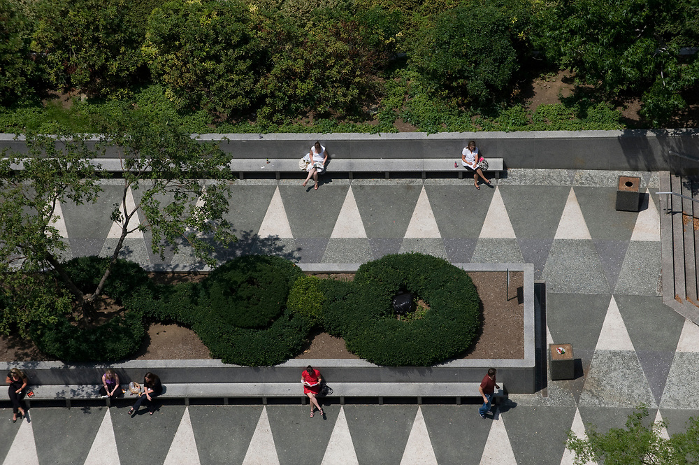 """Lunchtime in Mellon Square in downtown Pittsburgh. Renovations for the landmark park are scheduled to begin this year. Mellon Square is considered to be one of the nation's original """"green roofs""""."""