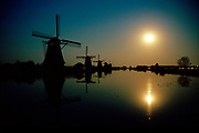 18th century windmills at full moon, Kinderdijk village, Unesco heritage