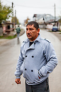 Portrait of Gheorghe Costoiu - one of the six elected local Roma councilors at the Saturday morning market place in Marginenii de Jos.