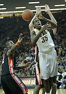 December 04 2010: Iowa Hawkeyes forward Devon Archie (35) can't grab the ball as Idaho State Bengals guard Broderick Gilchrest (2) looks on during the first half of their NCAA basketball game at Carver-Hawkeye Arena in Iowa City, Iowa on December 4, 2010. Iowa won 70-53.