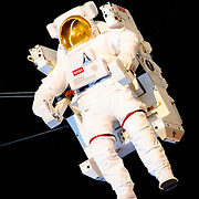NASA astronaut's space walking suit suspended in the air at the Smithsonian Air and Space Museum at Chantilly, Virginia