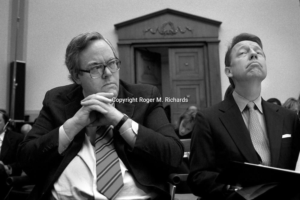President Bill Clinton's lawyers, Charles Ruff (left) and David Kendall, listen as independent prosecutor Kenneth Starr testifies about President Clinton during hearings of the U.S. House Judiciary Committee in Washington, DC, on November 19, 1998. (Photo by Roger M. Richards)