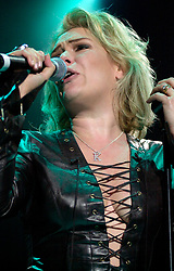 Kim Wilde steps out of the her TV Gardening clothes and Back on Stage to Tour with<br /><br />Steve Starnge (Visage)<br />Claire Grogan (Altered Images)<br />The Belle Stars<br />Dollar<br />Kim Wilde<br />The Human League<br />Play on the Here and Now  Christmas Party Tour at Sheffields Hallam FM Arena Friday 13th December 2002<br /><br />[#Beginning of Shooting Data Section]<br />Nikon D1 <br />2002/12/13 22:28:44.5<br />JPEG (8-bit) Fine<br />Image Size:  2000 x 1312<br />Color<br />Lens: 80-200mm f/2.8-2.8<br />Focal Length: 92mm<br />Exposure Mode: Manual<br />Metering Mode: Spot<br />1/200 sec - f/2.8<br />Exposure Comp.: 0 EV<br />Sensitivity: ISO 800<br />White Balance: Auto<br />AF Mode: AF-S<br />Tone Comp: Normal<br />Flash Sync Mode: Not Attached<br />Color Mode: <br />Hue Adjustment: <br />Sharpening: Normal<br />Noise Reduction: <br />Image Comment: <br />[#End of Shooting Data Section]