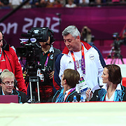 Mihai Brestyan, coach of Alexandra Raisman, USA,  talks with the judges after Raisman was placed fourth. Her position was upgraded from fourth to third during the Women's Gymnastics Apparatus Beam final at North Greenwich Arena during the London 2012 Olympic games London, UK. 7th August 2012. Photo Tim Clayton