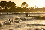 Race board surfing and paddling at sunset at Doheny in preparation for the Pacific Paddle Games.