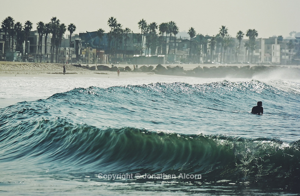 A wave at the shore at Venice Beach on another day of above average temperatures in Southern California while much of the rest of the U.S. is enduring freezing winter storms. NX300