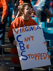 "A young UVA fan holds a sign that reads ""Virginia Can't Be Stopped"" at the Gator Bowl.  The Texas Tech Red Raiders defeated the Virginia Cavaliers 31-28 in the 2008 Konica Menolta Gator Bowl held at the Jacksonville Municipal Stadium in Jacksonville, FL on January 1, 2008."