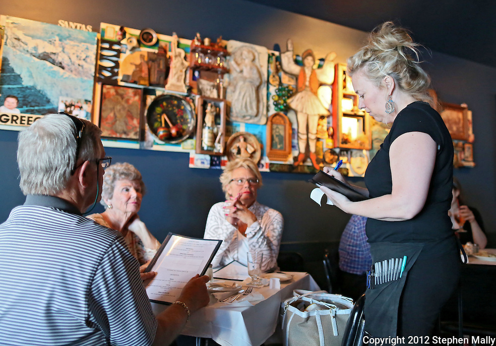 Ann Goodell (from right) of Cedar Rapids writes down the order from Julie Klinger, Pat Snyder, and Flip Klinger, all of Cedar Rapids, at Vernon Inn, 2874 Mount Vernon Road SE, in Cedar Rapids on Tuesday evening, May 15, 2012. (Stephen Mally/Freelance)