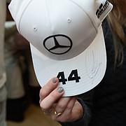 NLD/Amsterdam/20200229 - Lewis Hamilton lanceert de kledinglijn TommyXLewis, Mercedes Cap met handtekening Lewis Hamilton