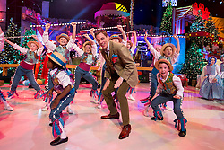 Repro Free: 28/11/2014<br /> Ryan Tubridy pictured during the opening performance of the RT&Eacute; Late Late Toy Show 2014 with a medley of songs from Chitty Chitty Bang Bang. Picture Andres Poveda