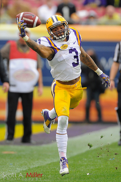 LSU Tigers wide receiver Odell Beckham (3) makes a one-handed catch during LSU's 21-14 win over the Iowa Hawkeyes in the 2014 Outback Bowl at Raymond James Stadium on Jan 1, 2014  in Tampa, Florida.            ©2014 Scott A. Miller