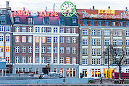 Bright neon Irma advertising signs as seen during the day over the lakes by Dronning Louises Bro in Copenhagen