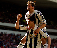 Photo: Jed Wee.<br />Sunderland v Newcastle United. The Barclays Premiership. 17/04/2006.<br /><br />Newcastle's Michael Chopra (R) jumps on the shoulders of goalscorer Albert Luque.