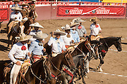 31 AUGUST 2007 -- PHOENIX, AZ: Riders process through the arena after competing at the Congreso y Campeonato Nacional Charro in Phoenix, AZ, Friday, August 31. The event is the US championship for the Mexican Federacion Mexicana de Charreria. The winners of the US championship go on to compete in the Mexican Charreada championships in Morelia, Michoacan, Mexico in October. Charreadas are Mexican style rodeos that are popular in Mexican communities throughout the US. As the Mexican immigrant community has expanded throughout the US, the sport has expanded with it. Charreadas are now held as far north as Minnesota and along the US - Mexico border.   Photo by Jack Kurtz