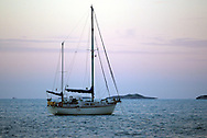 A post-sunset shot of a ketch at anchor near George Town.