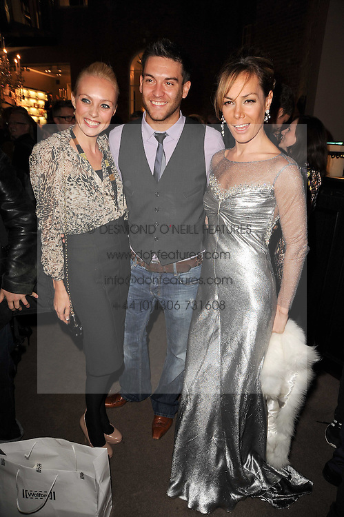 Left to right, CAMILLA DALLERUP, KEVIN SACRE and TARA PALMER-TOMKINSON at a party to celebrate the publication of Inheritance by Tara Palmer-Tomkinson at Asprey, 167 New Bond Street, London on 28th September 2010.