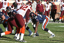 Virginia left tackle D'Brickashaw Ferguson (66) lines up against VT.  The Virginia Tech Hokies defeated The Virginia Cavaliers 52-14 on November 19, 2005 at Scott Stadium in Charlottesville, VA.