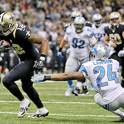 Dec 21, 2015; New Orleans, LA, USA; New Orleans Saints wide receiver Marques Colston (12) scores a touchdown past Detroit Lions cornerback Nevin Lawson (24) during the second half of a game at the Mercedes-Benz Superdome. The Lions defeated the Saints 35-27. Mandatory Credit: Derick E. Hingle-USA TODAY Sports