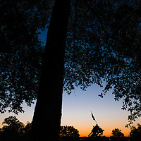 Sunrise silhouettes the U.S. Marine Corps War Memorial in Arlington, Va., on a cloudless morning in the Nation's Capital region Tuesday, Aug. 23, 2016.