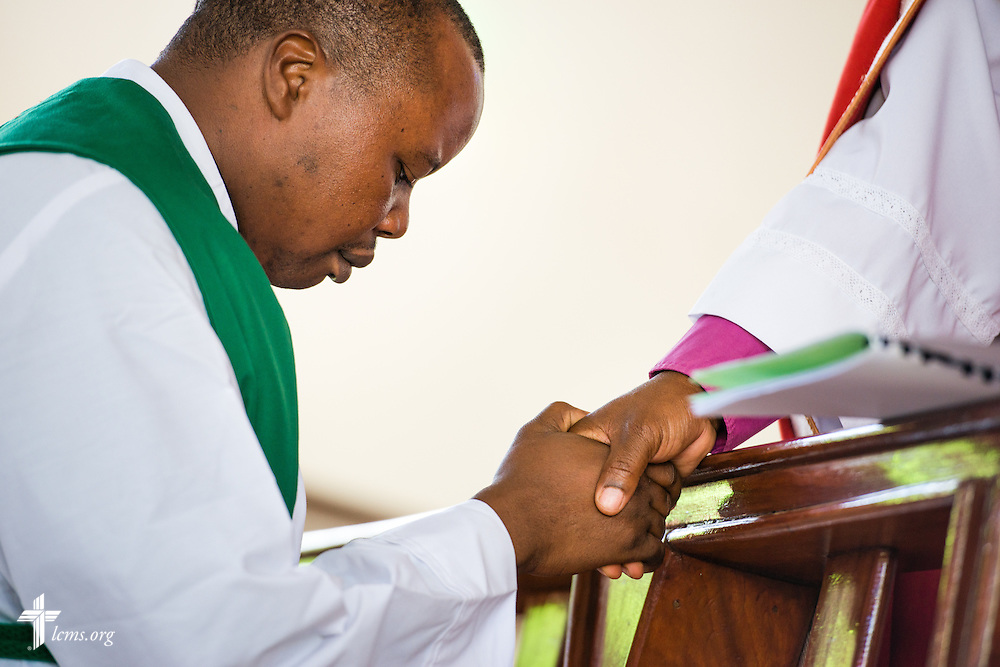 Led by Bishop Emmanuel Makala, pastoral candidate Frank Mdindi is ordained in a service with more than 1,000 worshippers on Sunday, March 15, 2015, at the Evangelical Lutheran Church in Tanzania – South-East of Lake Victoria Diocese's (ELCT-SELVD) Ebenezer Cathedral in Shinyanga, Tanzania. LCMS Communications/Erik M. Lunsford