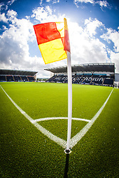 Sunlight catches behind the corner flag at The Falkirk Stadium, with the new pitch work for the Scottish Championship game v Morton. The woven GreenFields MX synthetic turf and the surface has been specifically designed for football with 50mm tufts compared with the longer 65mm which has been used for mixed football and rugby uses.  It is fully FFA two star compliant and conforms to rules laid out by the SPL and SFL.<br /> &copy;Michael Schofield.