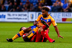 Nicky Maynard of Mansfield Town is brought down by Josh Coulson of Leyton Orient - Mandatory by-line: Ryan Crockett/JMP - 20/08/2019 - FOOTBALL - One Call Stadium - Mansfield, England - Mansfield Town v Leyton Orient - Sky Bet League Two