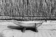 Utheemu Island.<br />Coconut scraper and cadjan wall. 2006