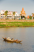 17 MARCH 2006 - PHNOM PENH, CAMBODIA: A fishing boat passes the waterfront area along the Tonle Sap River in Phnom Penh, Cambodia. Photo by Jack Kurtz / ZUMA Press