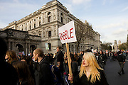 Students protest against government education cuts in Whitehall. .