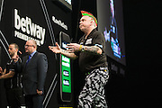 Peter Wright rues a missed shot at a double during the Premier League Darts  at the Motorpoint Arena, Cardiff, Wales on 31 March 2016. Photo by Shane Healey.