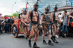 Men in bondage gear pulling chariot at the Christopher Street Day Parade in Berlin Germany 2011