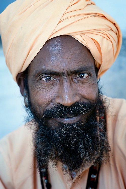 This saddhu (holy man) lives temporarily in ashram dedicated to the Indian god Shiva. He doesn't have a permanent place to live, but wanders through India, living on donations mainly.