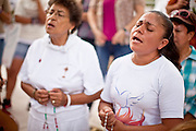 JULY 2010 -- PHOENIX, AZ: L to R: Maria Nowakowski (CQ), Georgina Sanchez (CQ), and others pray at an alter for the Virgin of Guadalupe in front of the courthouse Thursday. Thousands of people came to the Sandra Day O'Connor United States Courthouse (CQ) in downtown Phoenix Thursday. PHOTO BY JACK KURTZ