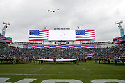 The American flag is on display on the stadium scoreboard and throughout TIAA Bank Field as U.S. military jets fly over the stadium during a Salute to Service game at the Jacksonville Jaguars NFL week 13 regular season football game against the Indianapolis Colts on Sunday, Dec. 2, 2018 in Jacksonville, Fla. The Jaguars won the game in a 6-0 shutout. (©Paul Anthony Spinelli)