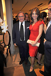 ELIZABETH HURLEY and DIEGO DELLA VALLE at a party to launch the book 'Italian Touch' - A Celebration of Italian Lifestyle held at TOD's, 2-5 Old Bond Street, London on 4th November 2009.