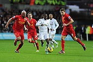 Swansea city's Nathan Dyer © goes past  Liverpool's Jose Enrique (l) and Steven Gerrard (r) .Barclays Premier league, Swansea city v Liverpool at the Liberty Stadium in Swansea , South Wales on Sunday 25th November 2012. pic by Andrew Orchard, Andrew Orchard sports photography,