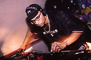 GOLDIE DJ on the decks, late 80s/early 90s
