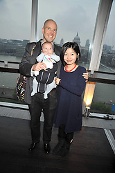 TIMOTHY and ASAKO d'OFFAY and their daughter Kokoro at the Montblanc de la Culture Arts Patronage Award 2009 held at the Tate Modern, Bankside, London SE1 on 16th April 2009.