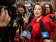 "14 JANUARY 2020 - DES MOINES, IOWA: US Senator AMY KLOBUCHAR holds up four fingers  while talking to a reporter from Fox News in the ""spin room"" at the CNN Democratic Presidential Debate on the campus of Drake University in Des Moines. Sen Klobuchar was saying Democrats in the Senate want to hear from four witnesses during President Trump's impeachment trial. This is the last debate before the Iowa Caucuses on Feb. 3.    PHOTO BY JACK KURTZ"