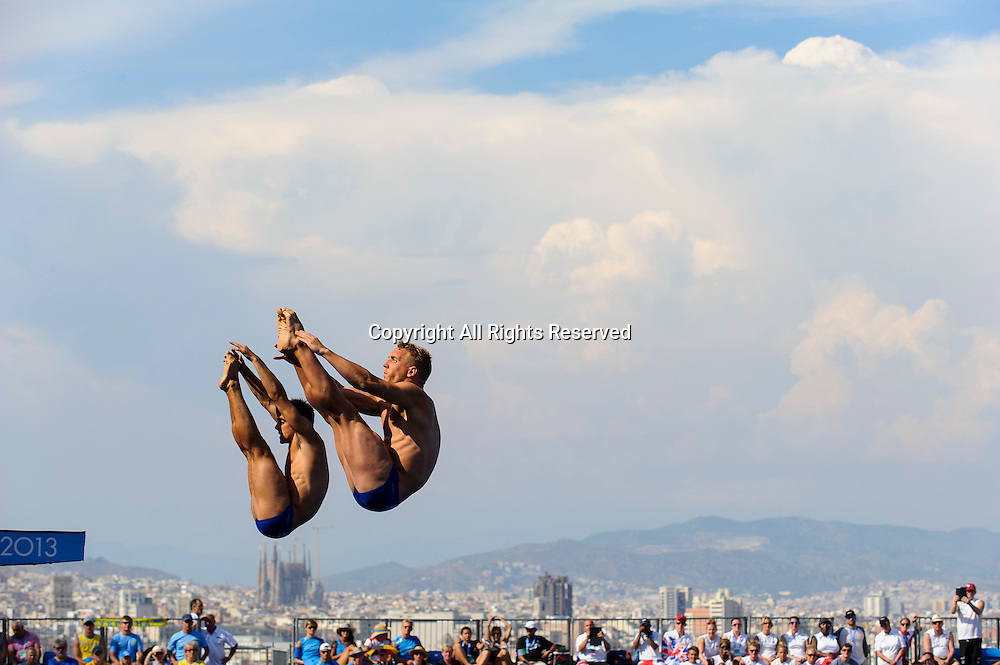 23.07.2013 Barcelona, Spain. Chris Mears and Nicholas Robinson-Baker of Great Britain (GBR) in action during the Mens 1m Synchronised Springboard Diving Final on Day 4 of the 2013 FINA World Championships, at the Piscina Municipal de Montjuic.