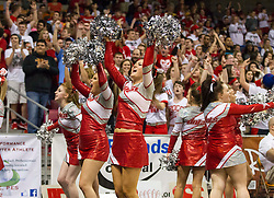 Poca cheerleaders cheer with the crowd during the Class AA championship game at the Charleston Civic Center.