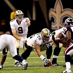 August 21, 2010; New Orleans, LA, USA; New Orleans Saints quarterback Drew Brees (9) under center during a 38-20 win by the New Orleans Saints over the Houston Texans during a preseason game at the Louisiana Superdome. Mandatory Credit: Derick E. Hingle