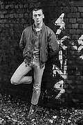 Symond next to graffiti, Cock Lane Bridge, High Wycombe, UK, 1980s.